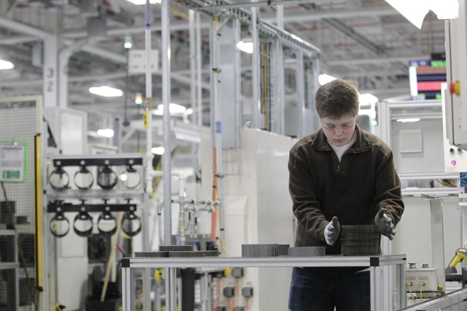 "An assembly line worker at a Chrysler plant in Kokomo, Ind. The carmaker's CEO said it remains ""on track."""