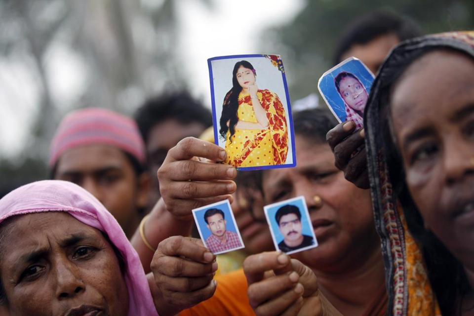 Protesters, with pictures of missing garment workers, demanded capital punishment Monday for those responsible for the collapse of the Rana Plaza building near Dhaka.