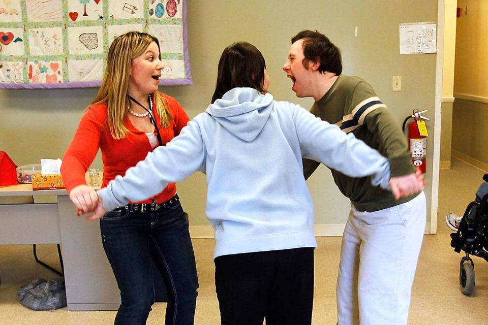 College for America student Ashley Collins (left) danced with Rachel Marshall and Shane Shaw at one of her three jobs.