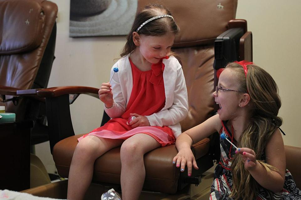 "Caroline ""Calle"" Cronk (left), who is battling a rare form of brain cancer, at best friend Lilah MaGee's birthday party in a nail salon."