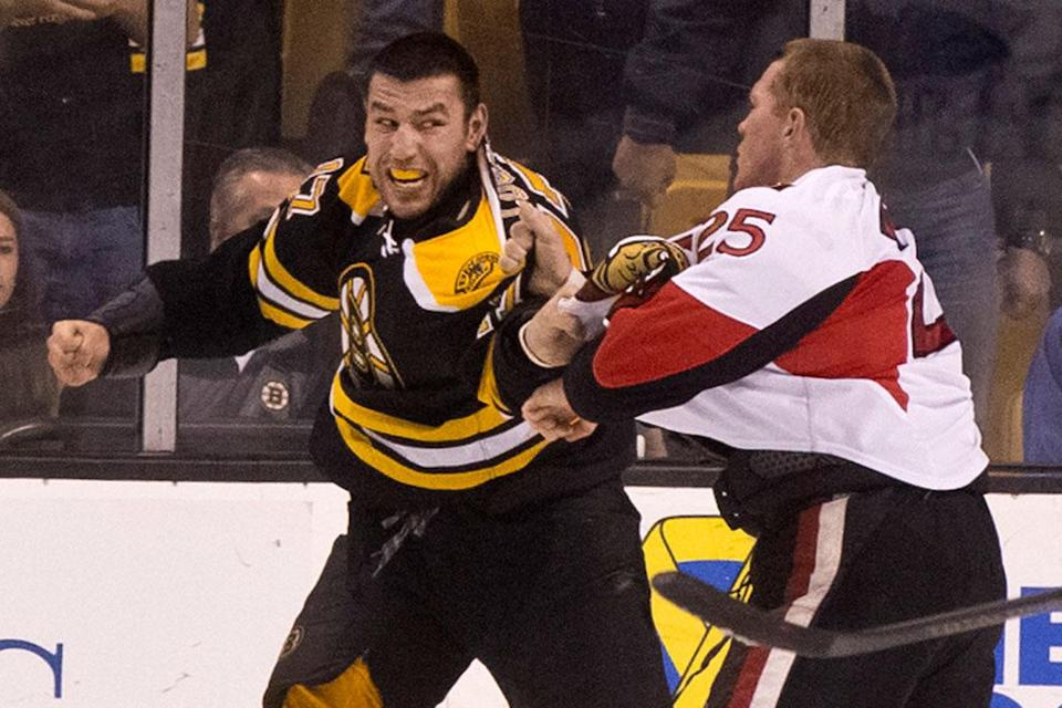 Milan Lucic looked rather menacing as he engaged in a heavyweight battle with Ottawa's Chris Neil in the first period.