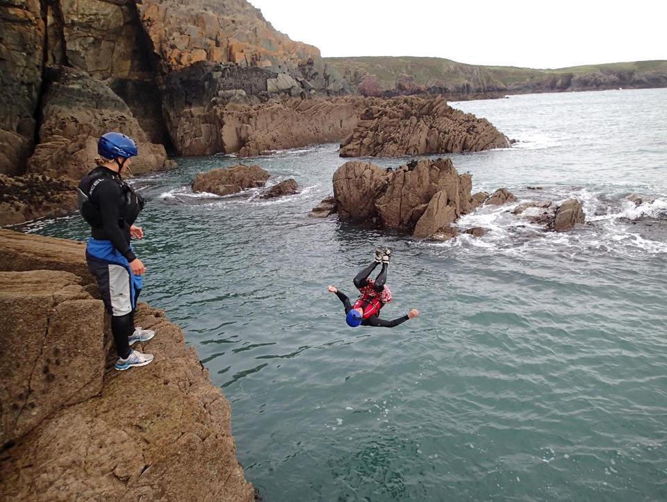 One way to traverse the coastline at St. Davids is to jump in and scramble along the rocks.