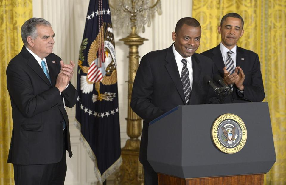 Anthony R. Foxx, mayor of Charlotte, N.C., (center) with President Obama and transportation chief Ray LaHood.