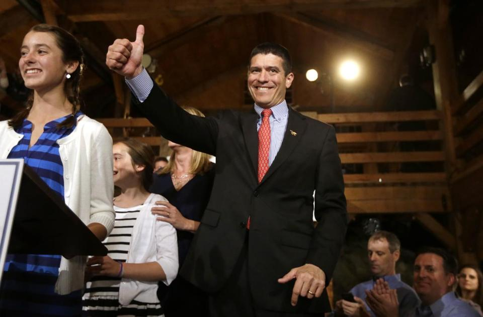 Republican nominee Gabriel Gomez gave a thumbs up to his supporters on his way down the stairs before giving his victory speech.