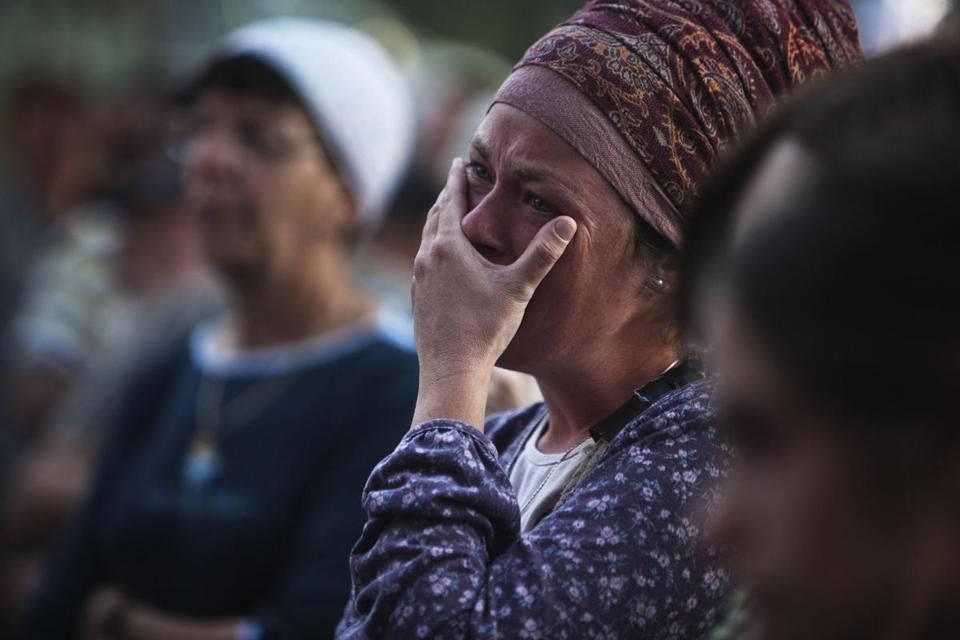 A woman grieved during the funeral Tuesday for Jewish settler and father of five Evyatar Borovsky, 31, near Haifa.