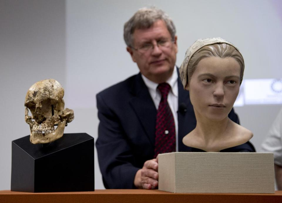 "Doug Owsley, division head for Physical Anthropology at the Smithsonian's National Museum of Natural History, displays the skull and facial reconstruction of ""Jane of Jamestown"" during a news conference."