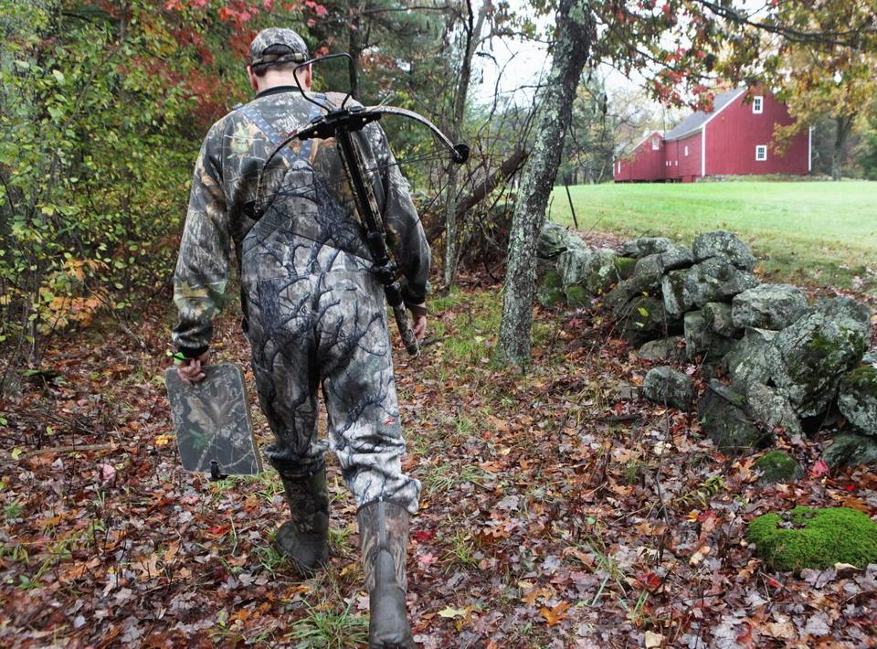 Deer hunter Dan Wolff walked through woods located next to a farm in Weston.