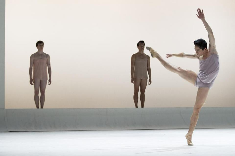 "Jeffrey Cirio (right) danced with Isaac Akiba (left) and John Lam in a  dress rehearsal of Boston Ballet's ""Chroma"" playing at the Boston Opera House."