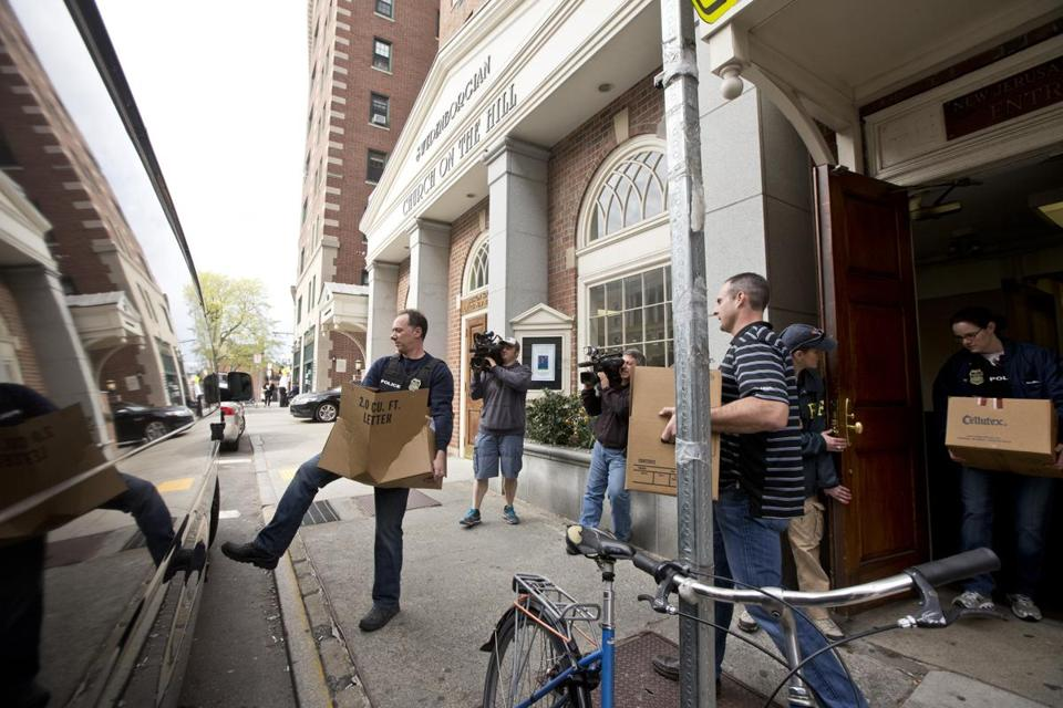 Federal investigators carried boxes from the Swedenborgian Church on the Hill on Thursday.