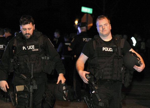 Detective Jon-Richard Gibson and Officer Mike Trovato, both of the Revere Police Department, after Dzhokhar Tsarnaev was apprehended in Watertown.