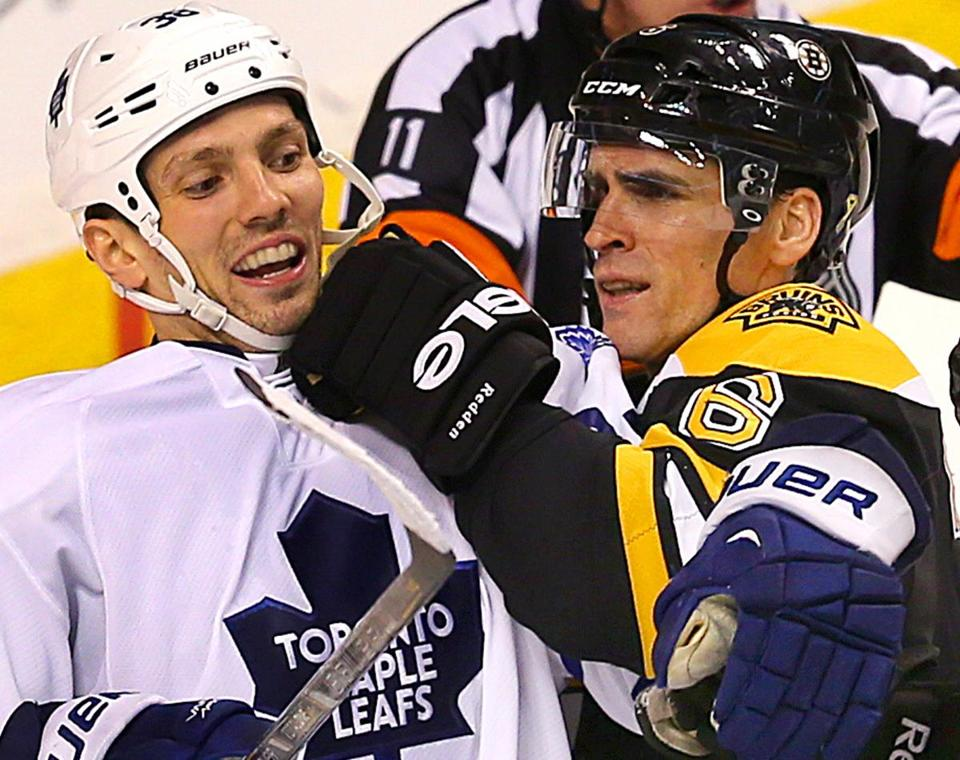 Bruins' Wade Redden played a little in-your-face hockey with Leafs' Frazer McLaren.