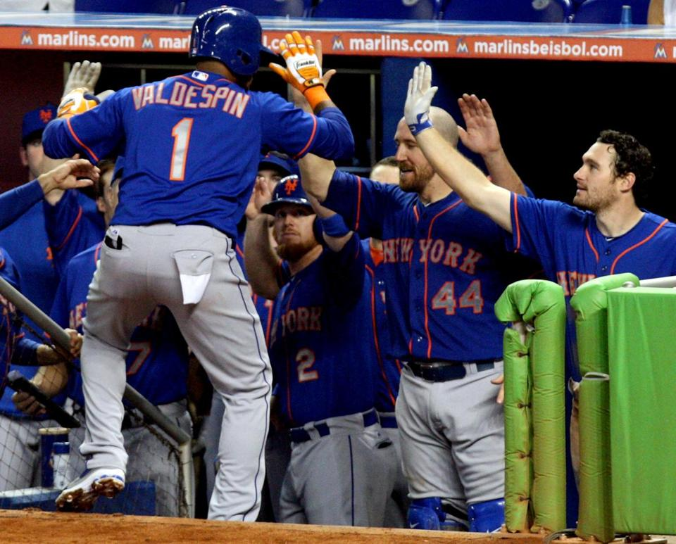The Mets' Jordany Valdespin high-fives his teammates after hitting his three-run homer in the sixth.