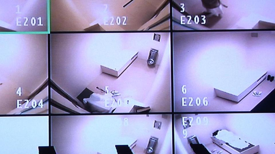 A live-streaming video frame grab from last month shows detainees' cells at Guantanamo Bay — some cells are empty, while other frames show detainees pacing or sleeping.
