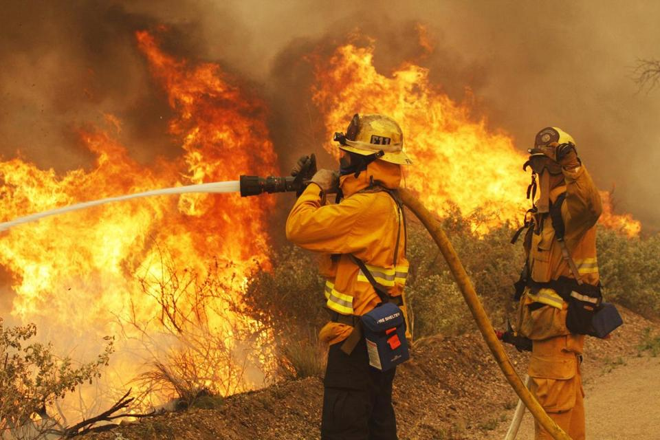 Firefighters worked at Point Mugu State Park, as a wind-driven wildfire raged along the California coast on Friday.