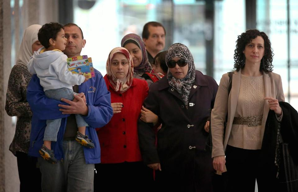 Friends and family of Abdella Ahmad Tounisi, 18, left a federal court building in Chicago.