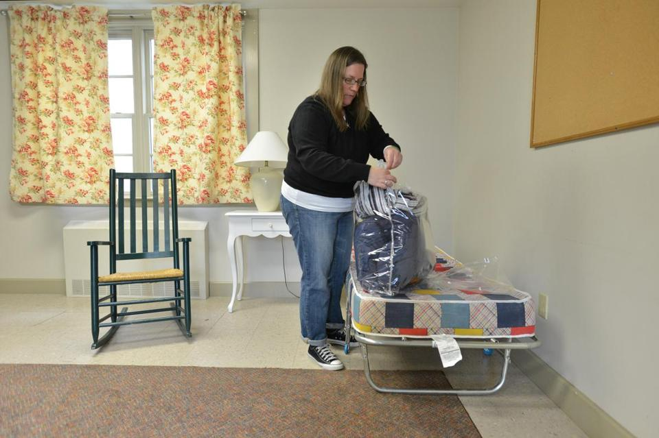 Susan Zwart readies a room at First Congregational Church of Essex for the arrival of homeless families.