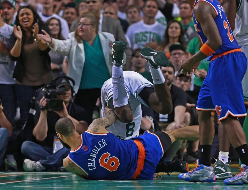 Celtics fans scream for a foul, which they got, when Jeff Green collides with Tyson Chandler in the fourth quarter.