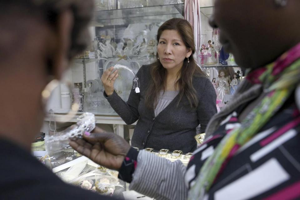 Itziar Llamoca, an immigrant from Peru, owns Fiesta Place, a party supply store in Port Chester, N.Y.