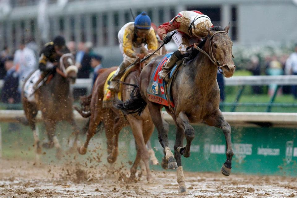 Muddied but unbowed, Orb and jockey Joel Rosario are headed for Kentucky Derby glory.