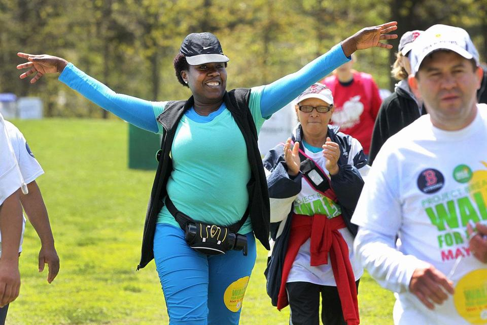 Pierreline Romain of Dorchester struck a celebratory pose in Arsenal Park in Watertown Sunday during Project Bread's 20-mile Walk for Hunger.