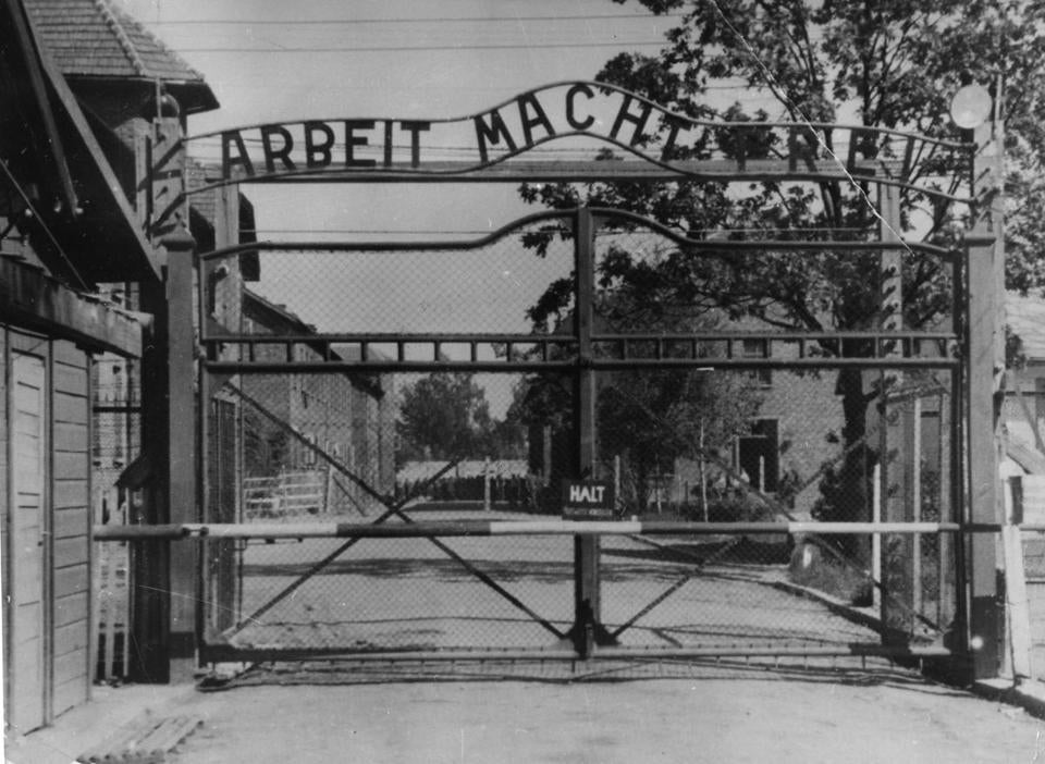 An undated image shows the gate of the Nazi's Auschwitz death camp in Poland. Hans Lipschis acknowledges being assigned to an SS guard unit but says he served as a cook.
