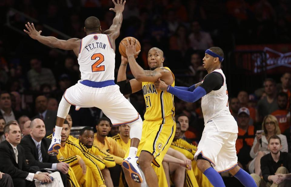 Indiana's David West gets boxed in by Knicks Raymond Felton and Carmelo Anthony.