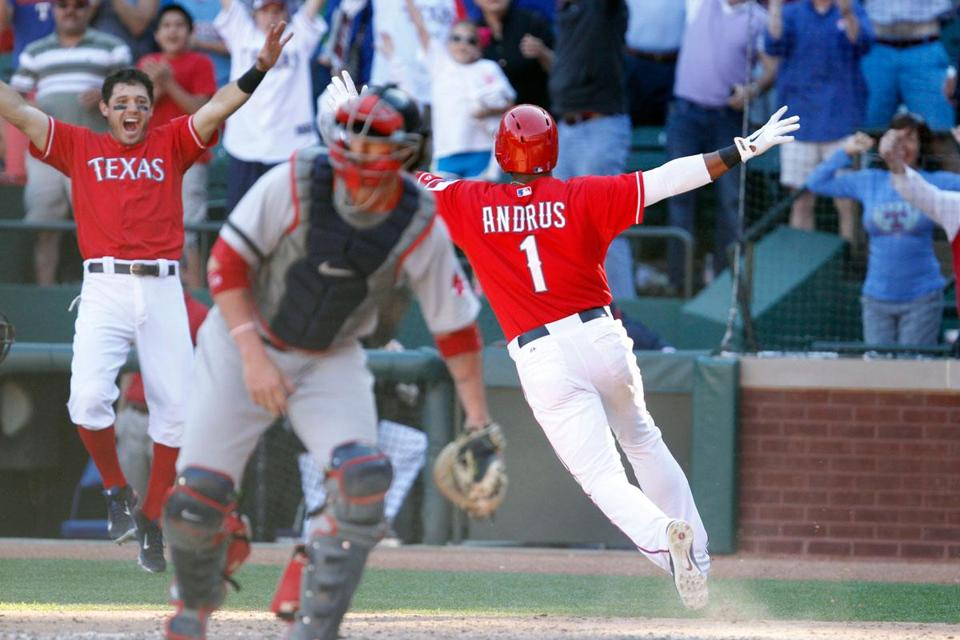 Elvis Andrus is flying high after crossing the plate with the winning run on an Adrian Beltre single in the ninth.
