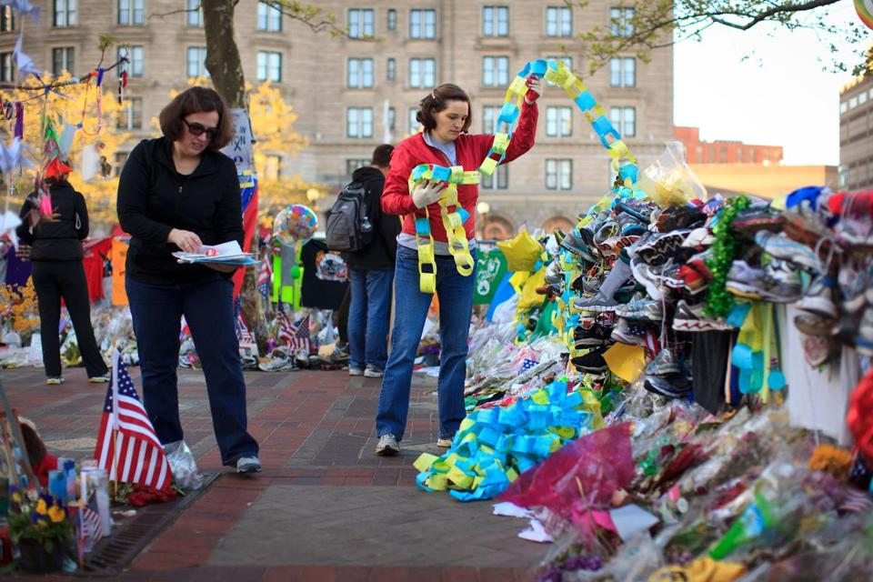 A team of city workers and archivists were working Tuesday morning to preserve paper memorials in Copley Plaza.