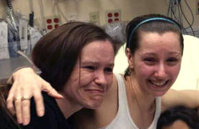 Amanda Berry, right, hugged her sister Beth Serrano after being reunited in a Cleveland hospital on Monday.