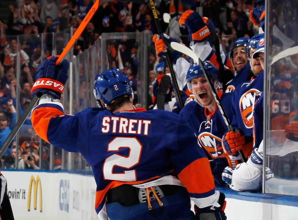 The Islanders' Mark Streit celebrates his second-period power-play goal, the first of two strikes vs. Pittsburgh.