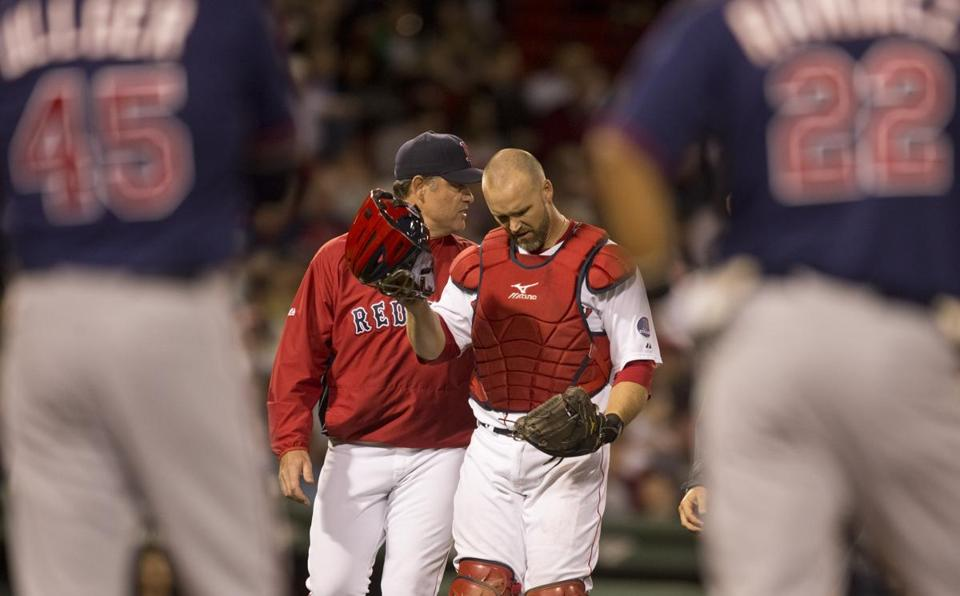 John Farrell walks off the field with David Ross after the catcher was banged up in a collision.