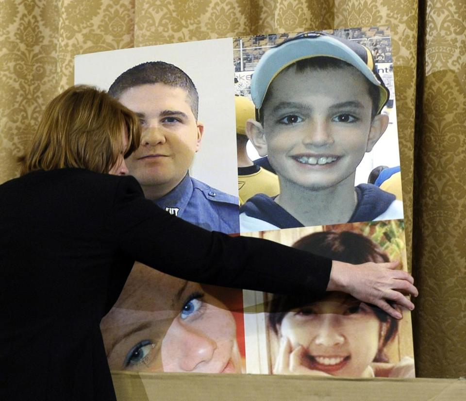 A poster board at Thursday's House Homeland Security Committee hearing memorialized those who died in Boston (clockwise): MIT police officer Sean Collier, Martin Richard, Lingzi Lu, and Krystle Campbell.