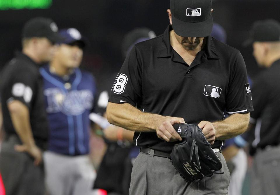 Umpire Chris Cuccione left a game last year with the glove of Tampa's Joel Peralta, the last player disciplined for doctoring a baseball.