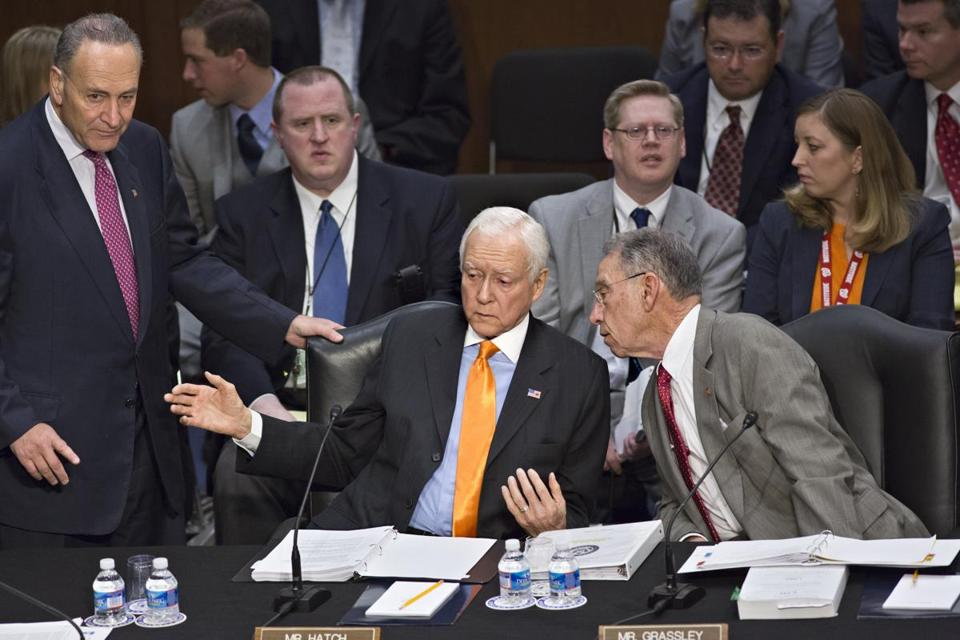 Democratic Senator Chuck Schumer of New York (from left, standing), Republican Senator Orrin G. Hatch of Utah, and Republican Senator Chuck Grassley of Iowa conferred as the Senate Judiciary Committee met on immigration reform Thursday.