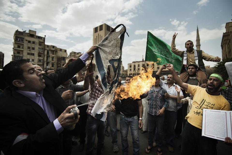 An Israeli flag was burned during a demonstration organized by the Muslim Brotherhood in Cairo on Friday.