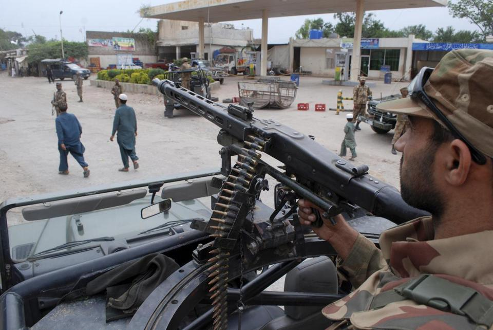 Pakistani soldiers took positions in Peshawar on Friday, a day before national elections.