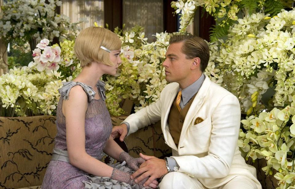 "Carey Mulligan as Daisy Buchanan, left, and Leonardo DiCaprio as Jay Gatsby in a scene from ""The Great Gatsby."""