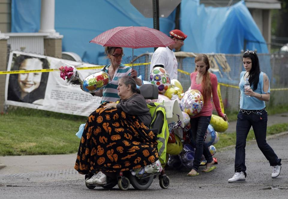 Deborah Knight (in wheelchair), grandmother of  ex-prisoner Michelle Knight, at the home of Gina DeJesus.