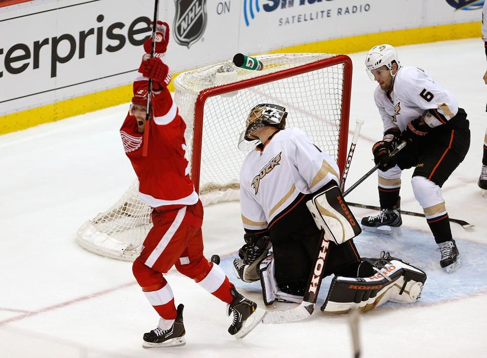Detroit's Daniel Cleary raises his stick in celebration after scoring in the third period.
