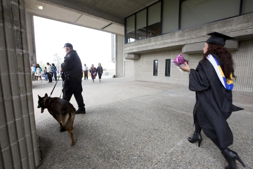 Bob Gillan, a Quincy officer, swept the campus Sunday with Ronan, an explosives detection canine.