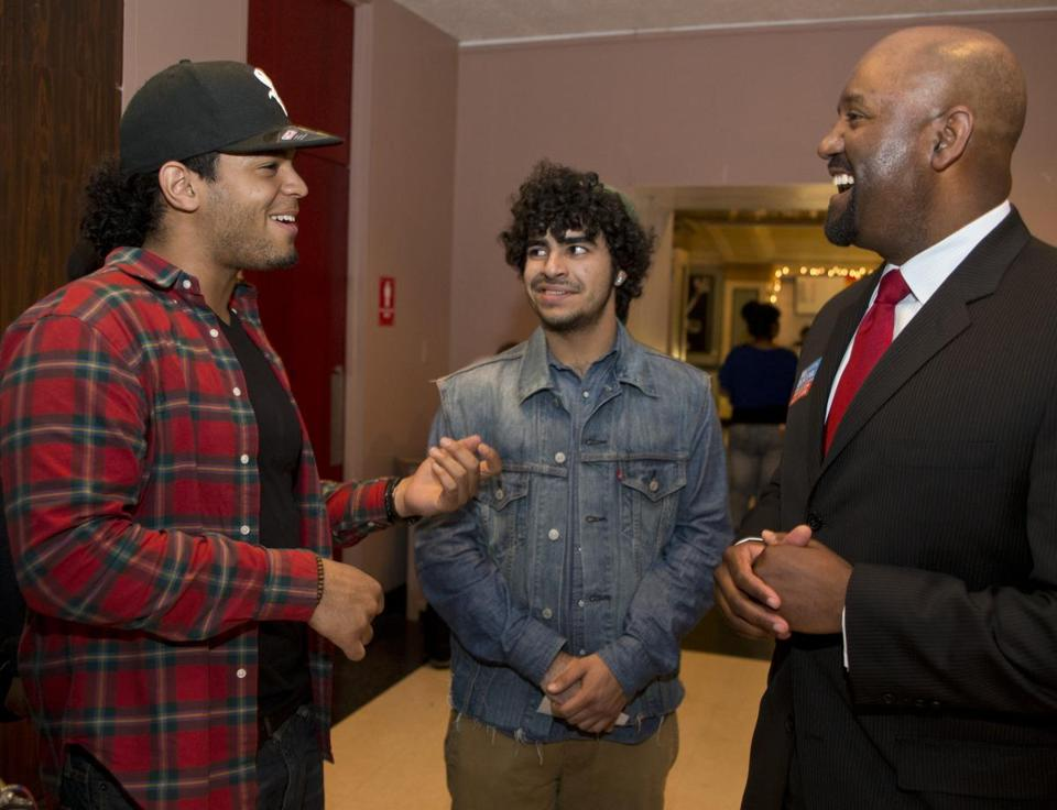 Sgardy Pena (left) and David Landing-Leal spoke to William J. Dorcena, a candidate for mayor, at Saturday's Youth Peace Conference at the Strand Theatre in Dorchester.