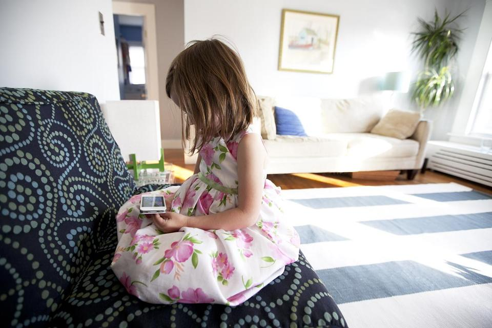 "Ruby McElhenny, 5, spent some ""screen time"" watching ""My Little Pony"" on an iPhone."