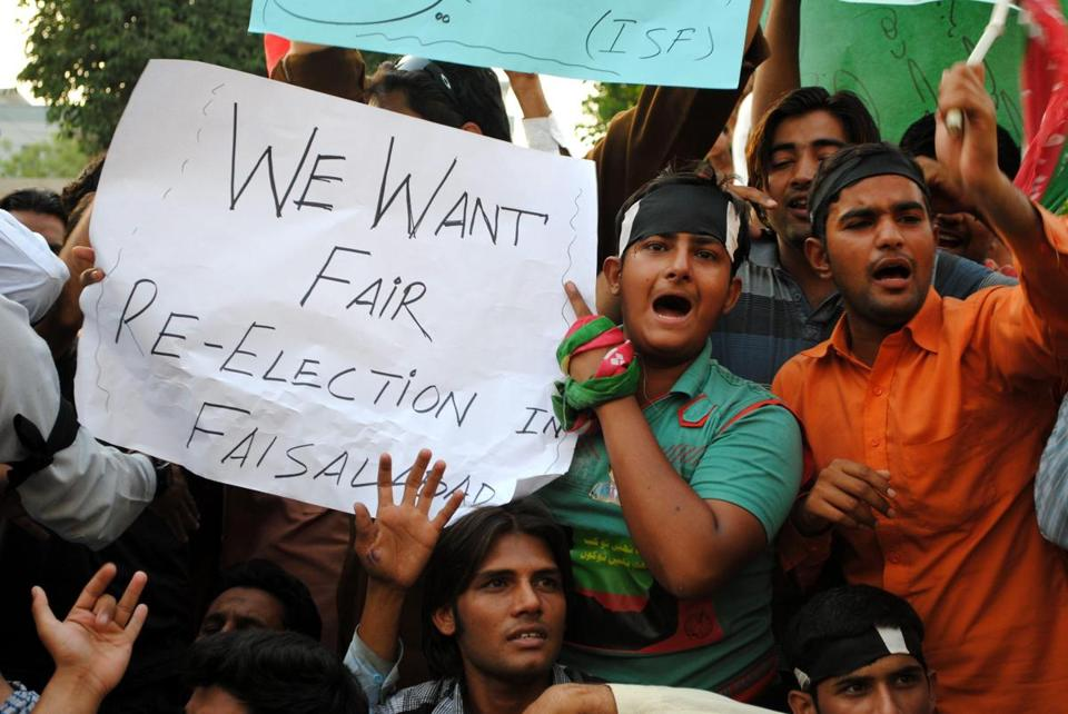 Supporters of candidate Imran Khan shouted slogans accusing officials of election fraud in Faisalabad, Pakistan.