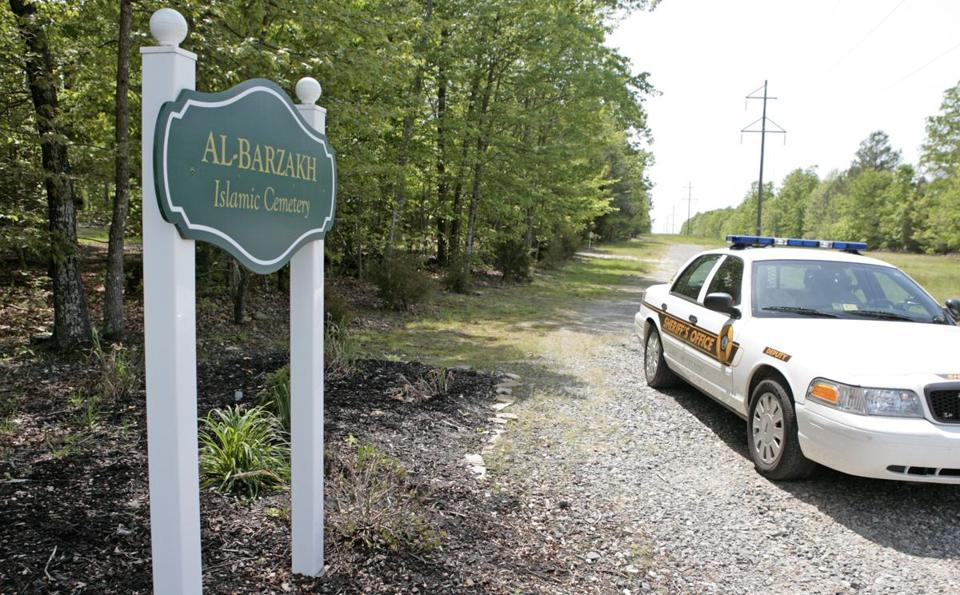 A police car sits next to a sign for Al-Barzakh Islamic Cemetery in Doswell, Virginia where Boston Marathon bombing suspect Tamerlan Tsarnaev has been buried.
