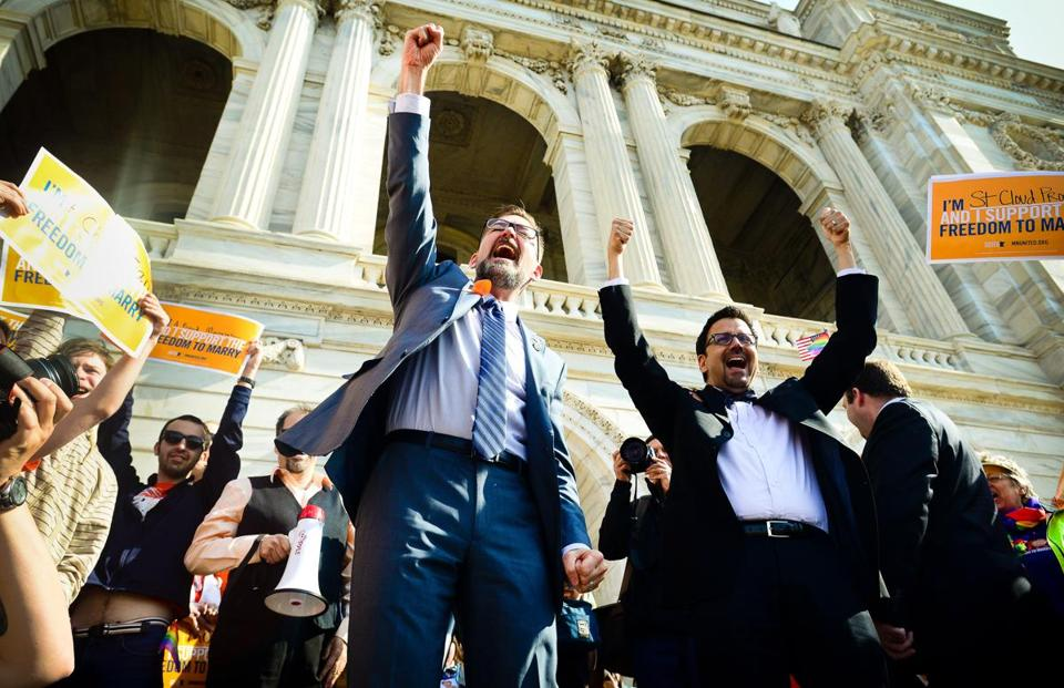 Senator Scott Dibble (left) celebrated Monday before the Minnesota Senate backed a gay marriage bill he sponsored.