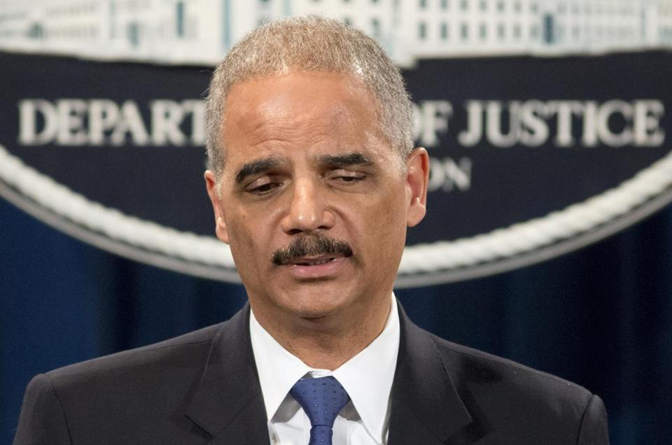Attorney General Eric Holder was questioned about the Justice Department secretly obtaining telephone records of reporters and editors for The Associated Press during a news conference.
