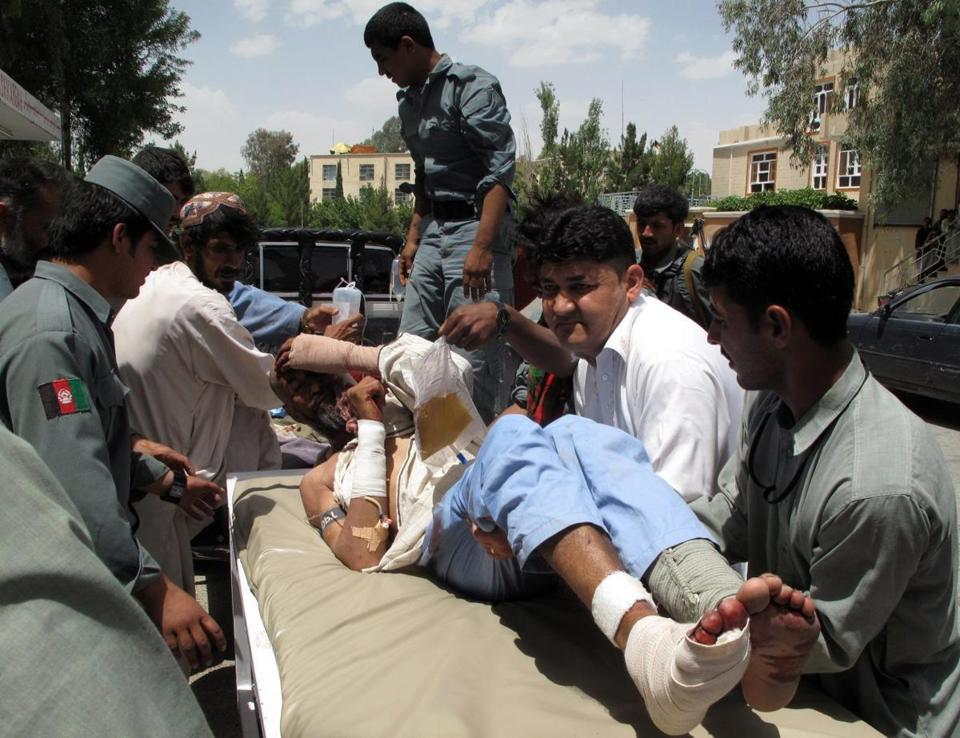 A man injured by a bomb blast in Lashkargah was loaded onto a vehicle on Tuesday.