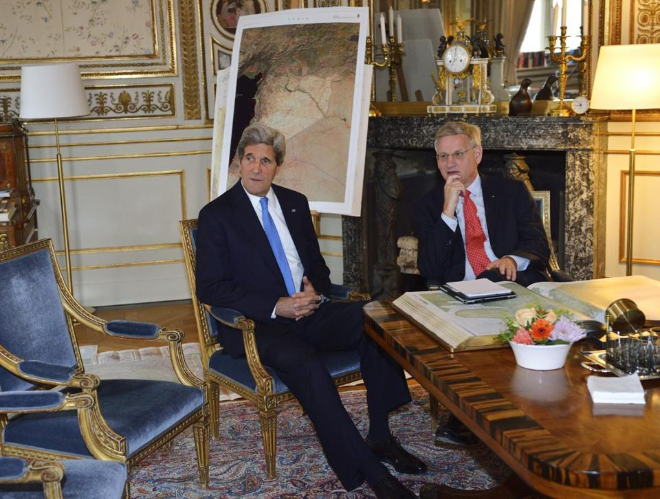 John Kerry, with Sweden's foreign minister, Carl Bildt, was in Stockholm, bound for a meeting of the Arctic Council.