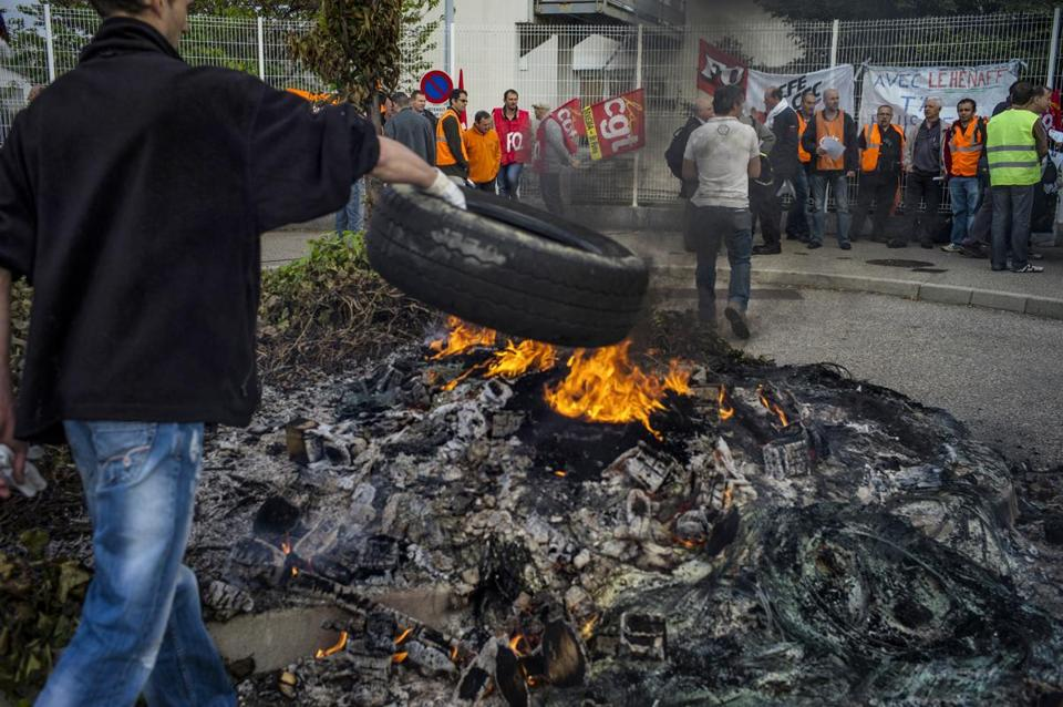 Employees of Kem One burned tires Tuesday as they protested possible job cuts in front of the company's factory in Pierre-Benite, France.