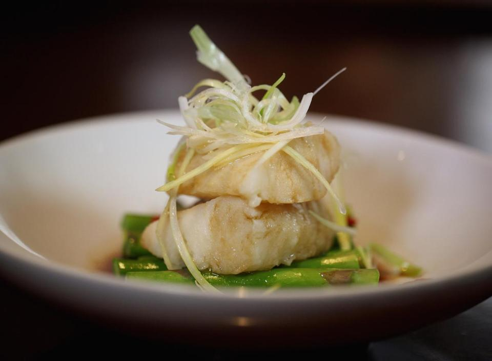 Chilean sea bass with ginger scallion sauce.